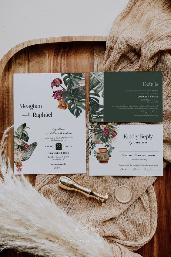 a tropical wedding invitation suite with neutral and green parts, with tropical leaf and floral prints and cages is a cool idea