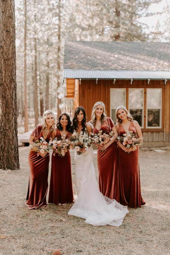 beautiful and refined burnt orange velvet maxi bridesmaid dresses with trains are adorable for a summer or fall boho wedding