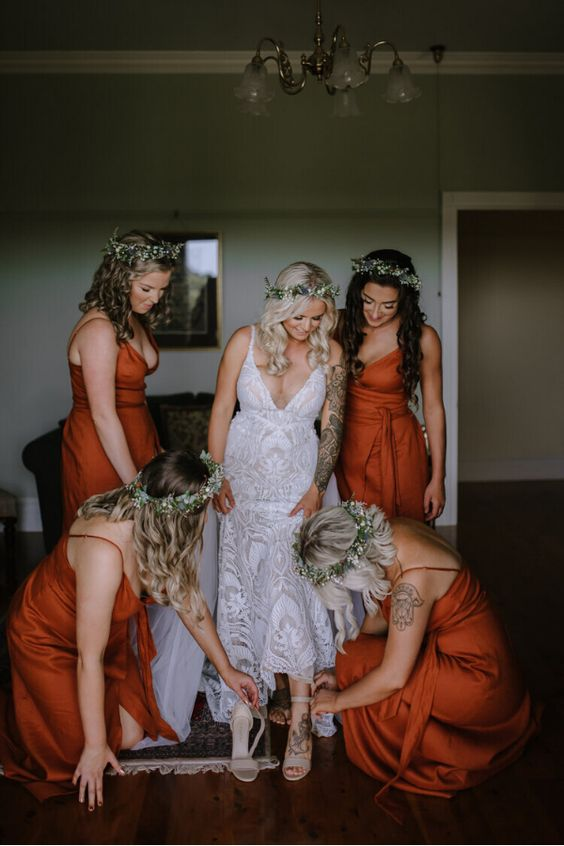 beautiful burnt orange wrap maxi bridesmaid dresses with satin sashes and spaghetti straps are lovely and romantic