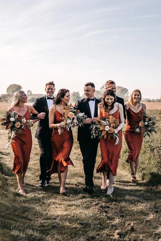 classic burnt orange slip bridesmaid dresses with mismatching shoes for an elegant fall wedding