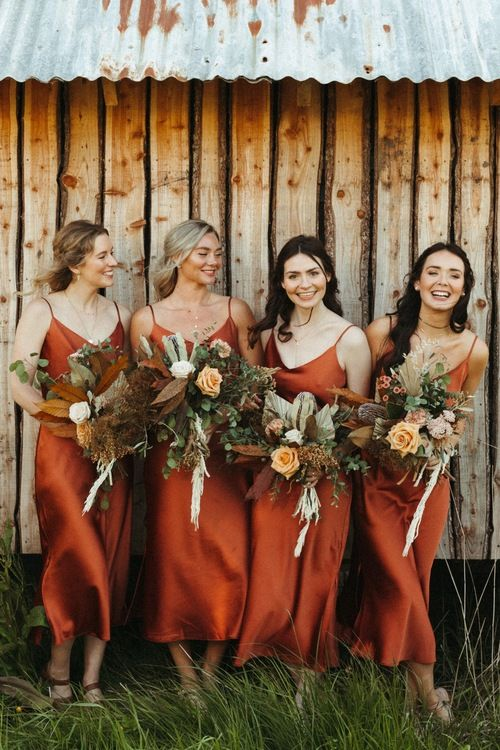 classic rust slip midi bridesmaid dresses will work for many boho weddings, will be good for a fall wedding