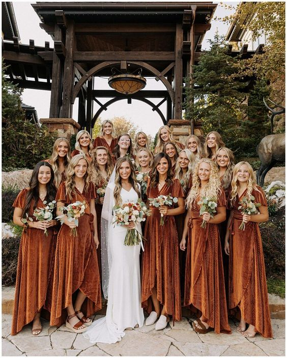 lovely rust velvet midi wrap high low bridesmaid dresses with short sleeves and mismatching shoes for a backyard boho wedding