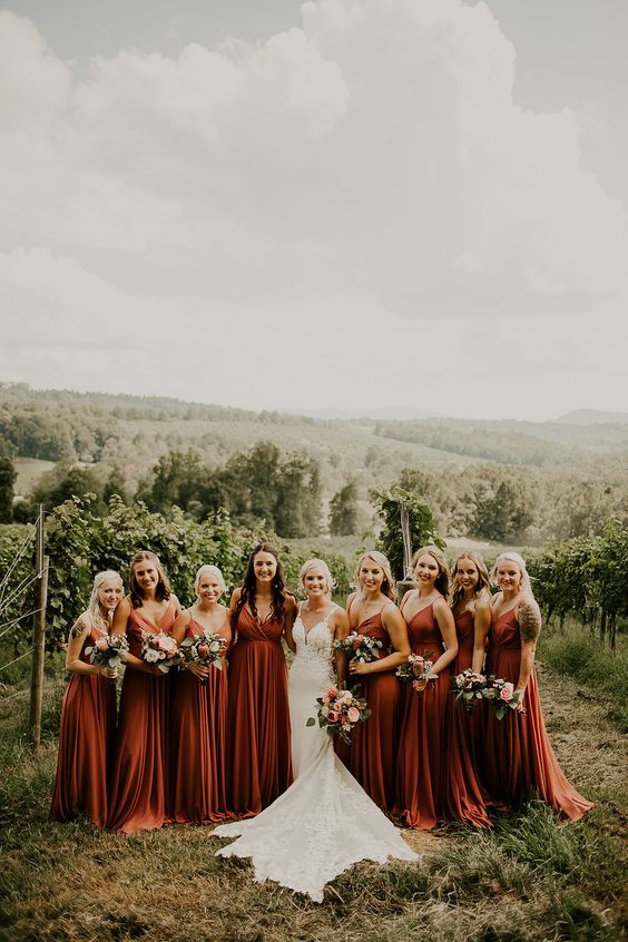 maxi rust slip bridesmaid dresses with pleated skirts and bodice, with spaghetti straps and a bit of trains look bold and cool