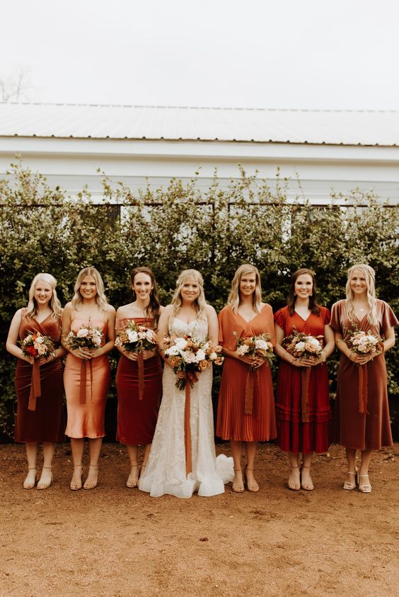 mismatching boho bridesmaid dresses - rust, burgundy, peachy, and amber ones, of velvet, satin and cotton for a fall wedding