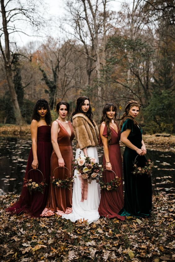 mismatching bridesmaid dresses - rust, emerald and burgundy maxi ones with various necklines look very chic and elegant