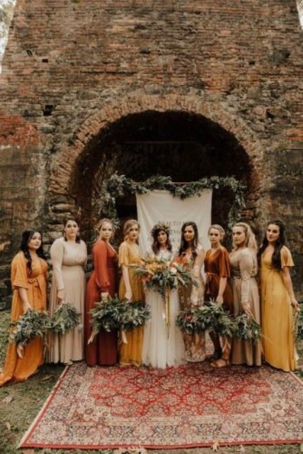 mismatching fall bridesmaid dresses - yellow, rust, creamy, orange ones made of lace, plain satin and velvet