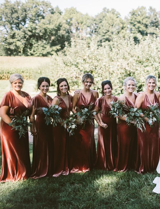 mismatching rust velvet maxi bridesmaid dresses with trains look luxurious and very refined and will match a fall wedding