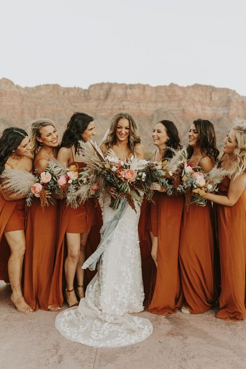 playful high low burnt orange maxi bridesmaid dresses on spaghetti straps are great for a boho wedding