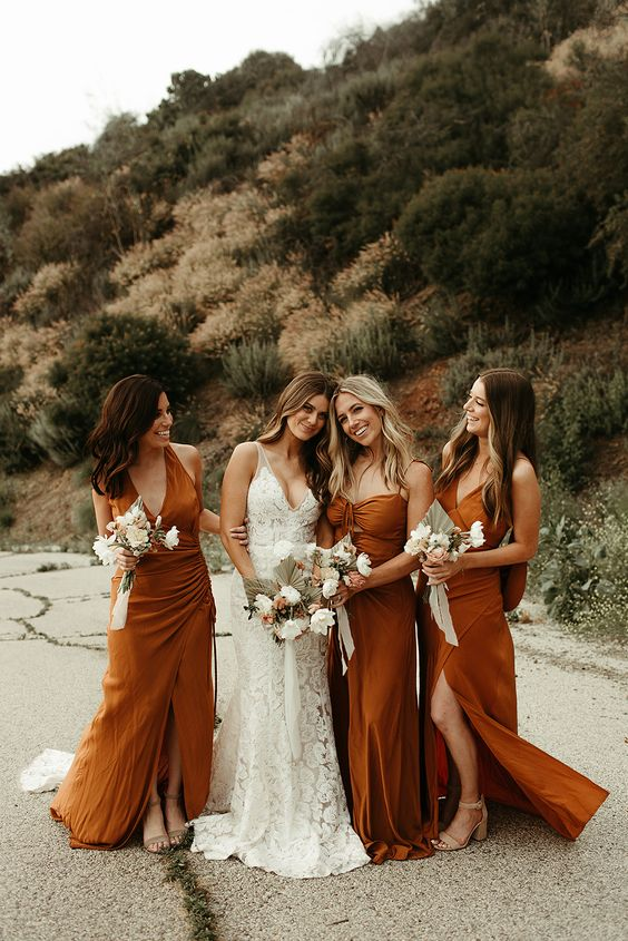 rust-colored maxi bridesmaid dresses, wrap, tied and a strappy one, with various necklines for a trendy and bold look