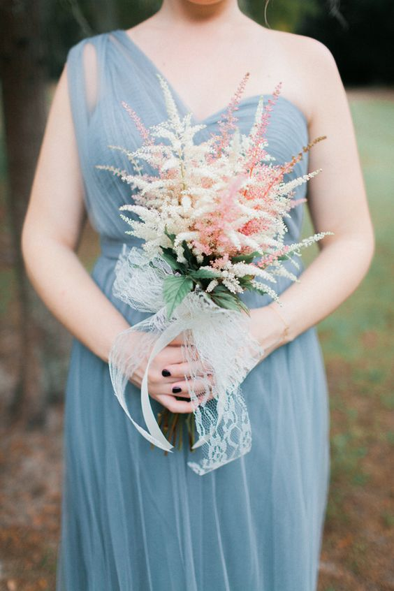 a beautiful and very simple bridesmaid bouquet with pink and white astilbe plus a lace bow is a very refined and cool idea