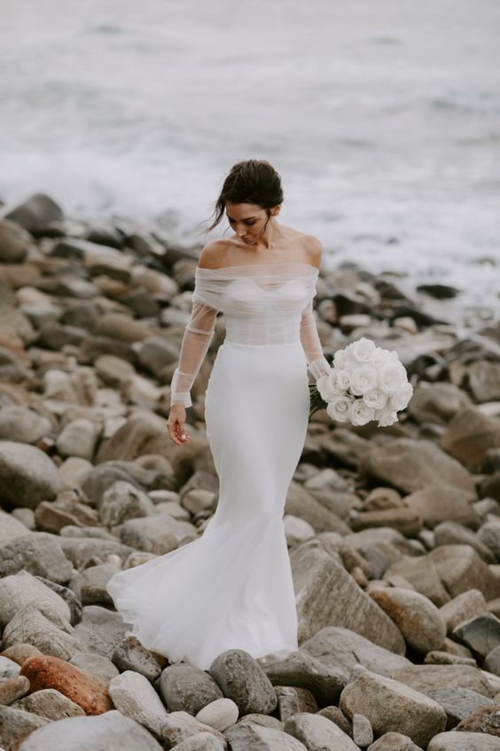 03 a beautiful modern glam wedding look with an off the shoulder mermaid wedding dress with illusion sleeves