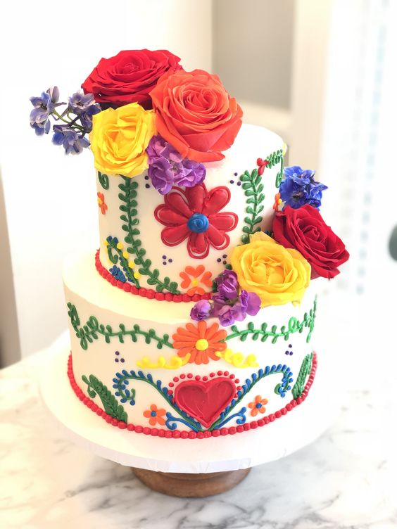 a bold wedding cake with colorful 3D floral and botanical patterns, bold blooms on top for a Mexican wedding