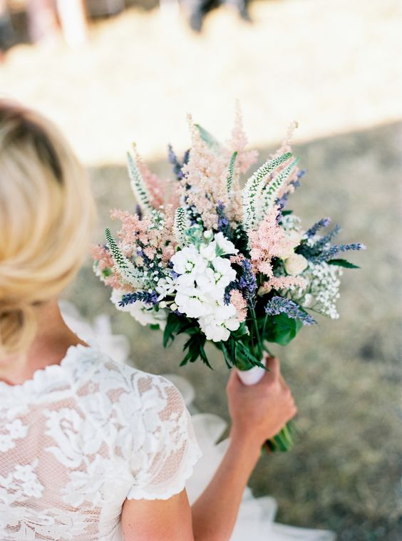 a beautiful Provence wedding bouquet of white blooms, white and pink astilbe and lavender looks fantastic