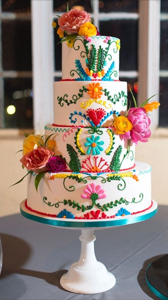 a bright Mexican wedding cake with bold floral and botanical 3D patterns and bright fresh blooms is amazing