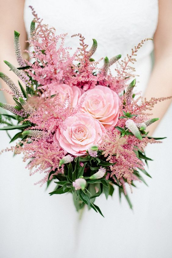 a bright and cool wedding bouquet with pink blooms and astilbe plus greenery is a vivacious and fun idea