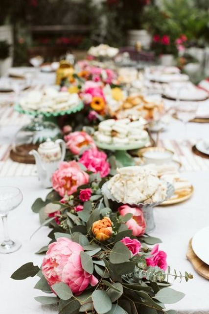06 a bold wedding table runner with eucalyptus, hot pink peonies and orange and pink blooms is a bright and cool decor idea