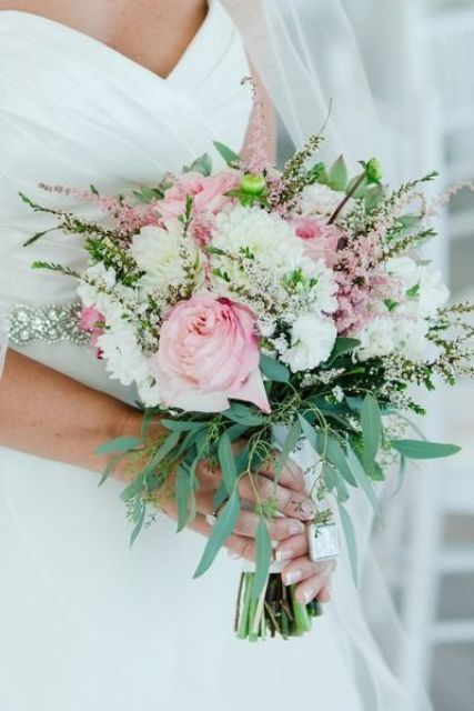 a chic wedding bouquet with white and pink blooms, pink astilbe and greenery plus a crystal hanging is amazing