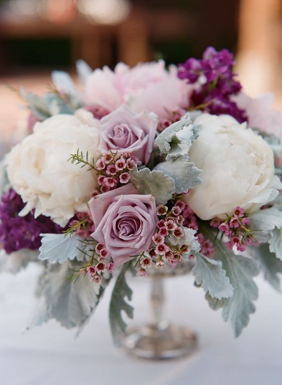08 a chic wedding centerpiece of white peonies, lilac roses, pink blooms, pale greenery and purple touches is a lovely idea