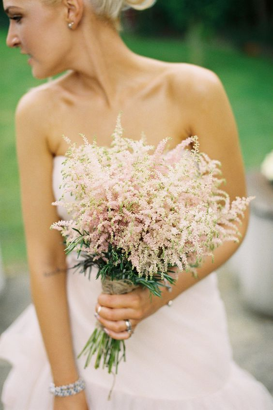 a lovely astilbe wedding bouquet with a yarn wrap is a lovely idea for a spring or summer wedding that doesn't look too formal