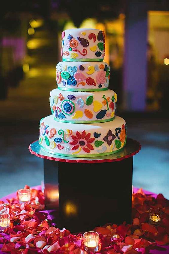 a colorful Mexican wedding cake with bright 3D floral patterns and leaves is a lovely and pretty idea for your wedding