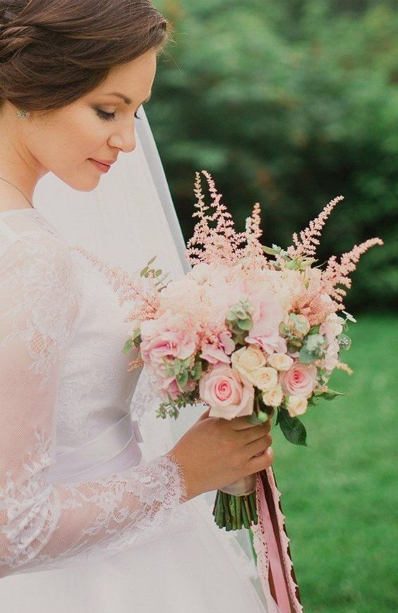 a romantic wedding bouquet with pink and neutral roses, eucalyptus, pink astilbe is a lovely and very beautiful idea