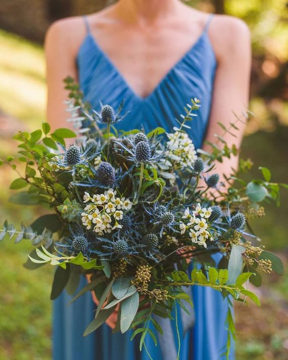 a gorgeous wedding bouquet with thistles, white blooms, berries and lots of eucalyptus will fit a non-floral wedding