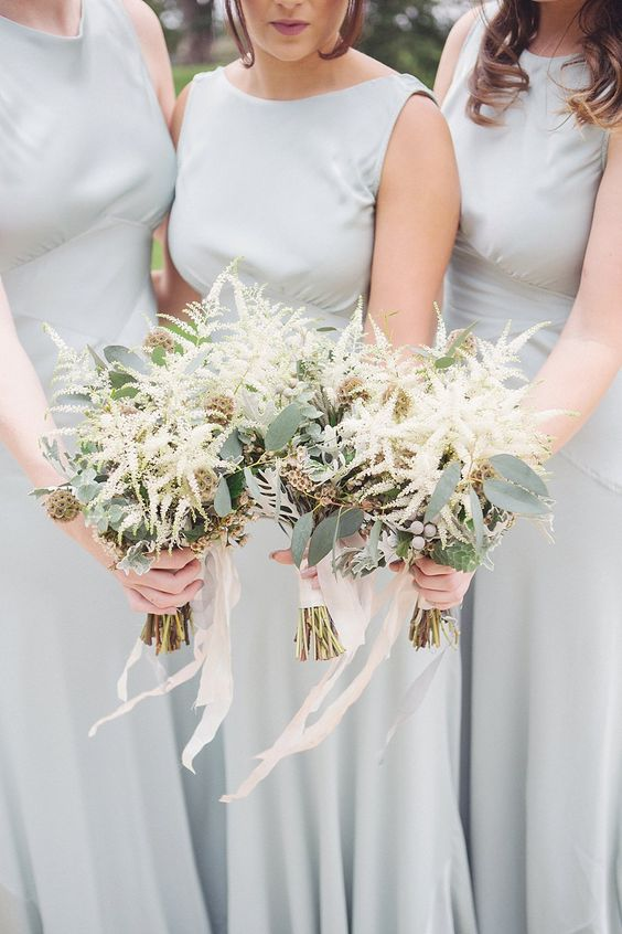 lovely bridesmaid bouquets with white astilbe, berries and seed pods are stylish and cool for spring and summer