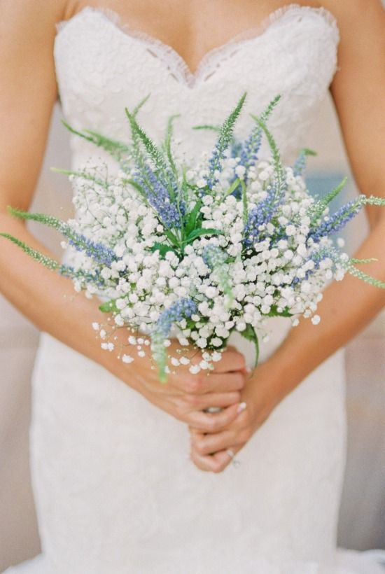 an ethereal wedding bouquet made of baby's breath and blue astilbe is a very pretty and out of the box idea
