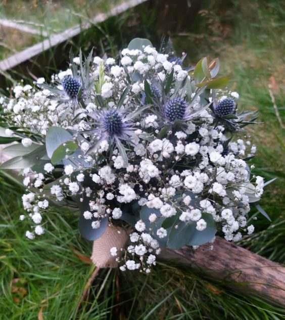 a lovely rustic wedding bouquet with baby's breath and thistles plus eucalyptus is a fantastic idea