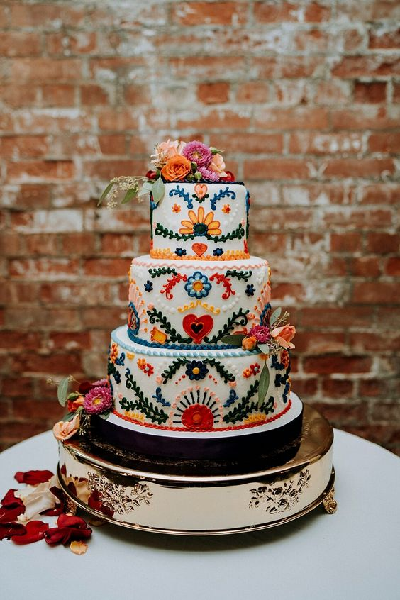 a traditional bright floral Mexican wedding cake - these sugar blooms are 3D ones, and there are matching fresh flowers