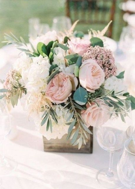 a romantic wedding centerpiece of a wooden box, blush peonies, blush blooms and white hydrangeas and greenery for a rustic wedding