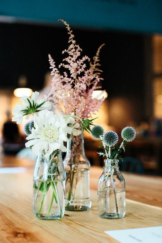 a cluster wedding centerpiece with white blooms, balls and pink astilbe is a pretty rustic wedding decor idea to rock