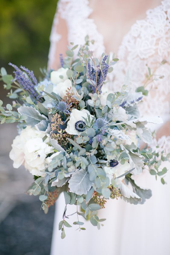 a tender and fresh wedding bouquet with white anemones and hydrangeas, thistles, pale leaves and eucalyptus is a beautiful solution