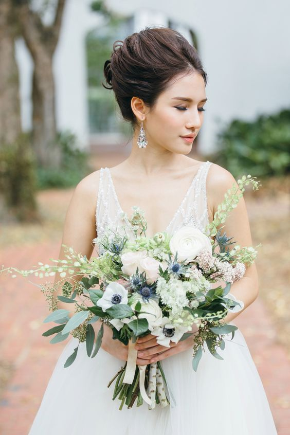 an elegant and chic wedding bouquet with white roses and anemones, thistles and eucalyptus is a gorgeous idea