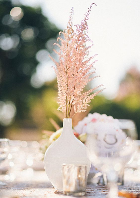 a minimalist wedding centerpiece of a white sleek vase and pink astilbe is a lovely and very cool idea
