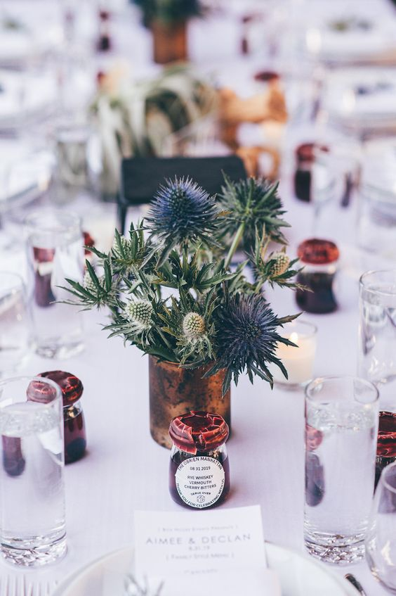 a chic wedding centerpiece of a vintage tin can and some thistles is a lovely idea for a rustic wedding