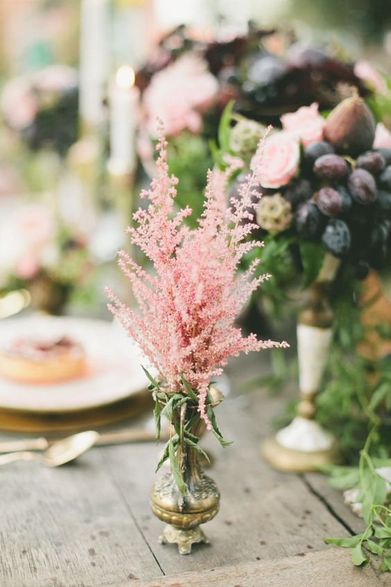 a refined vintage wedding centerpiece of a gilded vase and pink astilbe is a very beautiful and simple idea