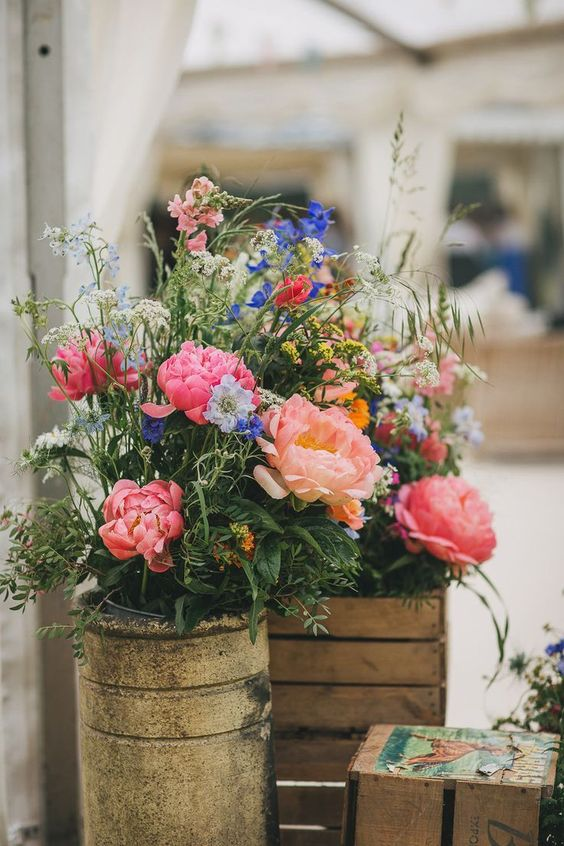bright floral arrangements with pink and coral peonies, blue and light blue blooms, white blooming branches