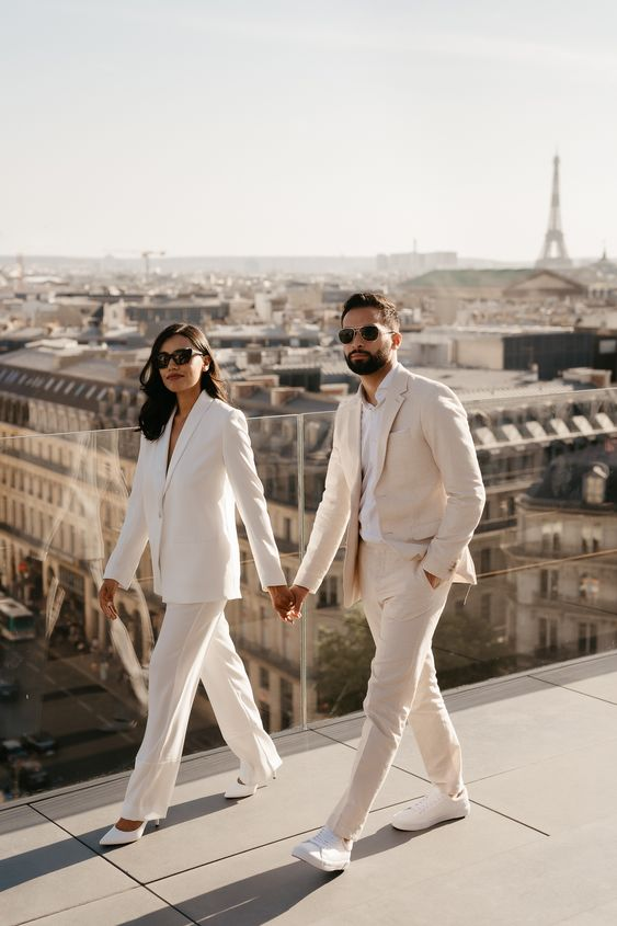 an elegant white wedding pantsuit with an oversized blazer and white heels for an adorable look