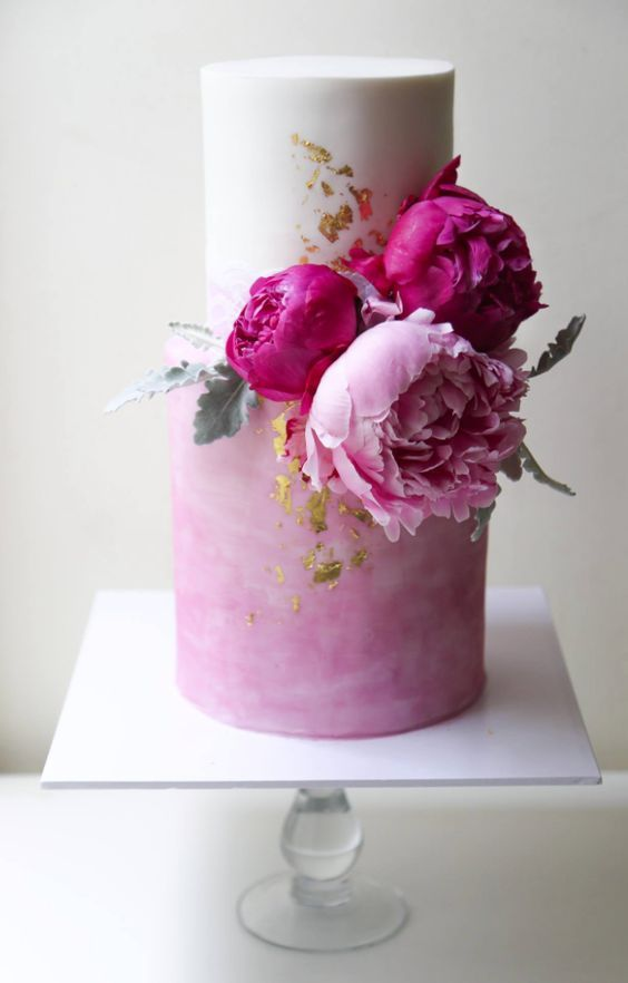41 a trendy white and watercolor pink wedding cake with fuchsia and light peonies plus pale leaves and gold leaf