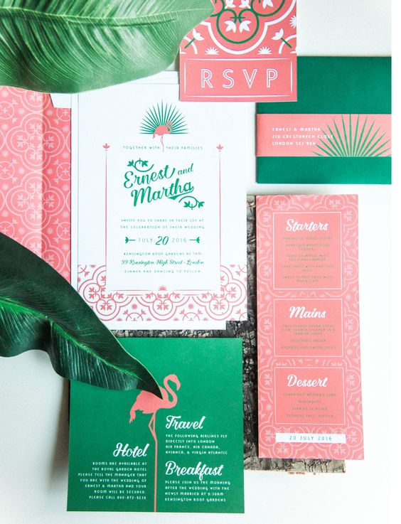 a bold tropical wedding invitation suite in pink and emerald, with lovely calligraphy and flamingo and floral prints