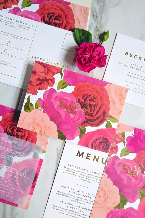 a bold floral wedding invitation suite with red, pink and hot pink blooms and gold lettering for a garden summer wedding