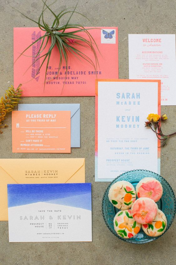 a bold mid-century modern wedding invitation suite with colorful envelopes, color blocking and bold edges