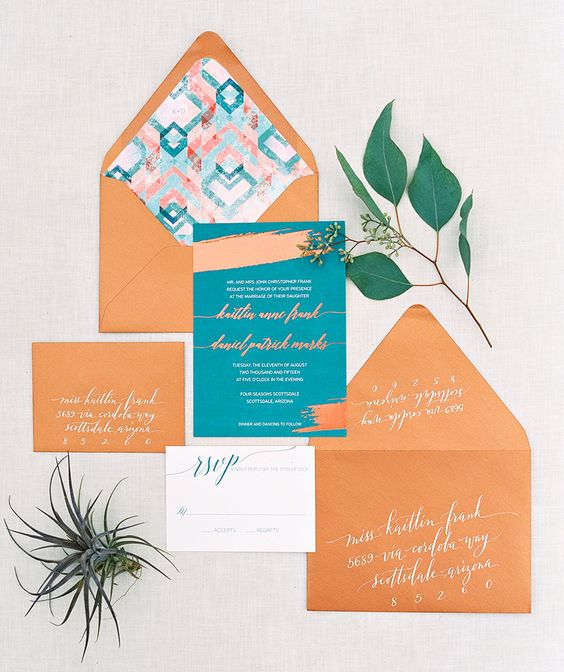 a bright boho wedding invitation suite in rust and teal, with geometric print lining is a fun and cool idea