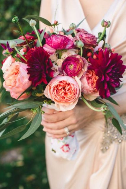 a bright wedding bouquet with burgundy, fuchsia and blush blooms and some greenery is a fun and cheery idea