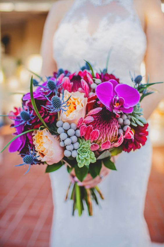 a bright wedding bouquet with hot pink, pink, blush blooms, berries, succulents and thistles is a cool idea