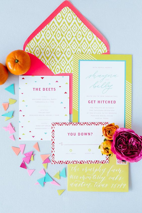 a bright wedding invitation suite with a pink envelope, bold yellow invites, geometric prints is amazing