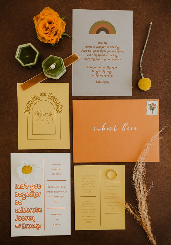 a bright wedding invitation suite with bold envelopes and invites done in the 70s colors is a lovely idea