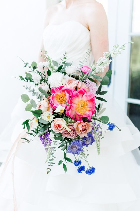 a brigth wedding bouquet with pink, blue, purple and white blooms and foliage is a lovely idea with much texture