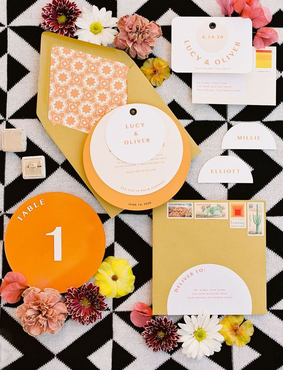 a cheerful mid-century modern wedding invitation suite in mustard, orange and with cool geometric prints